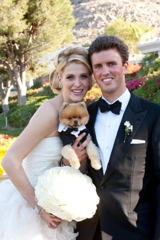 bride-and-groom-with-dog-on-wedding-day
