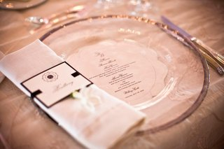 menu-card-under-clear-charger-plate