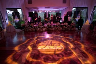 floral-embellished-stage-and-monogram-lighting