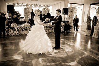 black-and-white-photo-of-newlyweds-dancing-and-stage