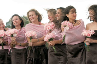 bridesmaids-on-windy-day-with-brown-dresses-and-pink-sweaters
