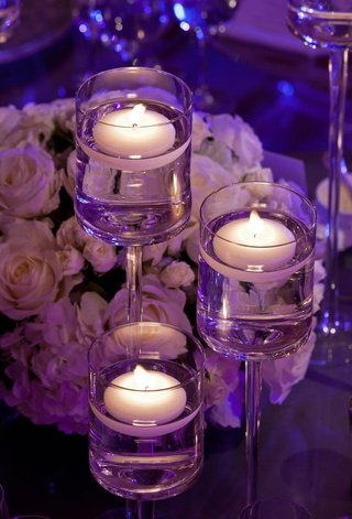 purple-wedding-floating-candle-centerpieces