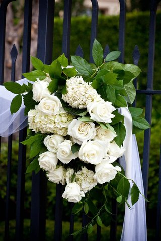white-roses-and-hydrangeas-on-wrought-iron-gate