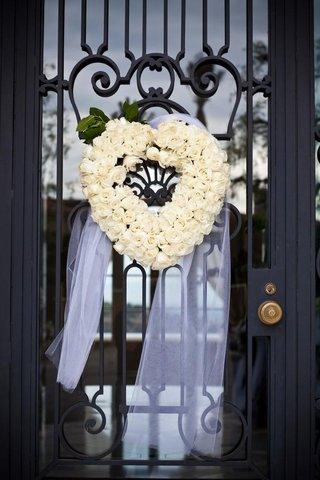 floral-wreath-in-the-shape-of-a-heart-on-door