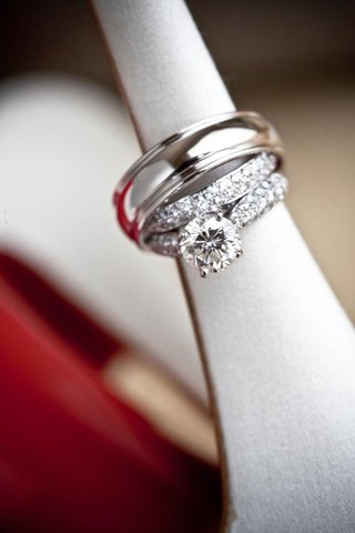 round-cut-diamond-ring-and-silver-wedding-band