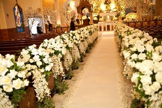 church-pews-decorated-with-ivory-floral-arrangements