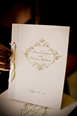white-ceremony-booklet-with-gold-lettering