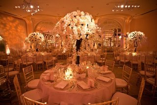 round-tables-topped-with-tall-floral-arrangements
