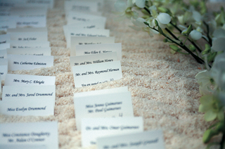 rows-of-place-cards-surrounded-by-flowers