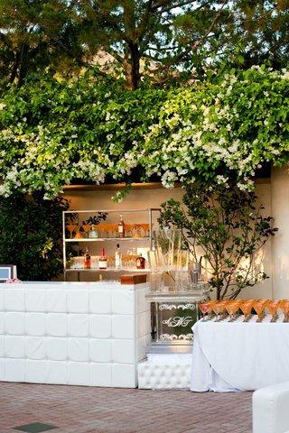 white-cushion-bar-with-orange-martini-glasses