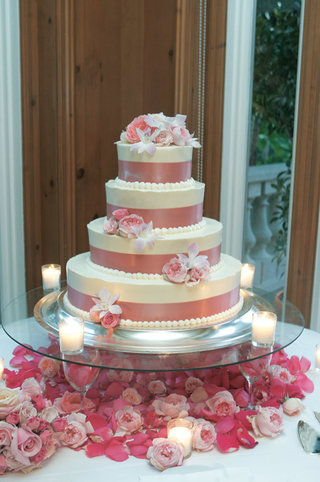 four-tier-wedding-cake-in-pink-and-white