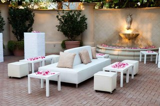 white-furniture-with-pink-rose-petal-decorations