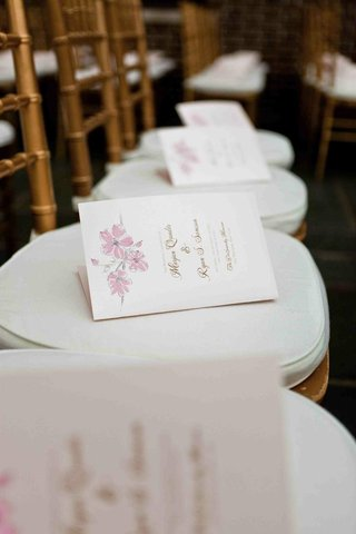 wedding-ceremony-programs-on-chairs-with-floral-motif