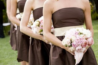 bridesmaids-in-brown-dresses-hold-pink-peony-bouquets