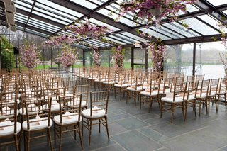 wedding-ceremony-in-atrium-with-purple-flowers-on-ceiling