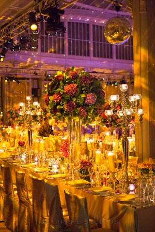 table-swathed-in-golden-lighting-and-candles