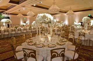 white-rosette-tablecloths-and-gold-chairs