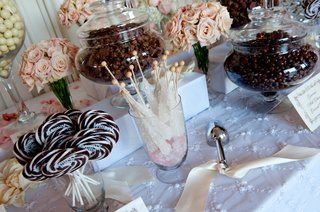 glass-apothecary-jars-with-lollipops-rock-candy-and-chocolate