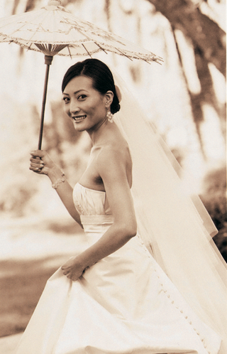 sepia-toned-photo-of-bride-holding-umbrella