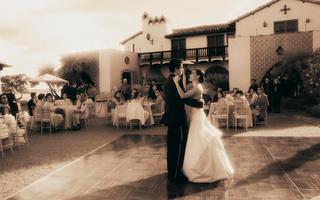 sepia-toned-photo-of-bride-and-groom-dancing