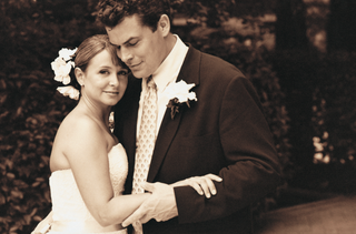 sepia-tone-picture-of-bride-and-groom-embracing