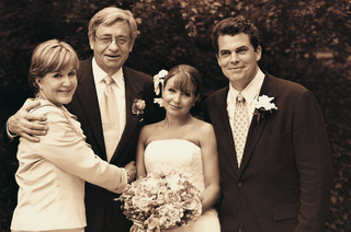 sepia-tone-image-of-bride-and-groom-with-parents