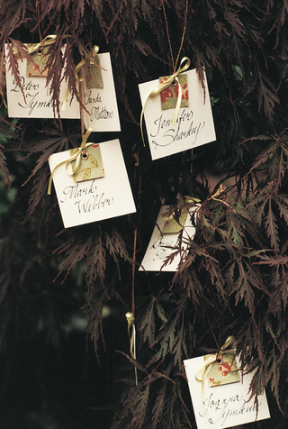 flower-motif-wedding-place-cards-hanging-from-tree