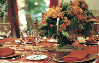 wedding-reception-with-orange-flowers-and-decorations