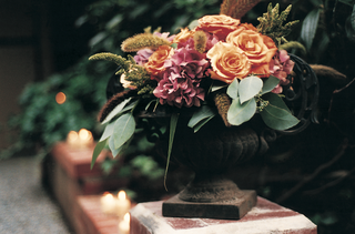 autumn-style-centerpiece-with-burgundy-and-orange-flowers-and