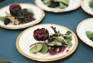 gold-rimmed-plate-topped-with-beet-and-goat-cheese-salad