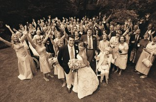 sepia-tone-picture-of-bridal-party-and-wedding-guests