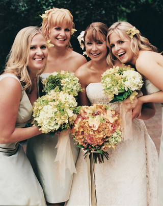bridesmaids-in-short-mismatched-dresses-with-green-bouquets