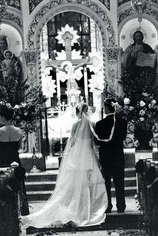 black-and-white-photo-of-bride-and-groom-wearing-wedding-crowns
