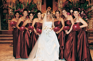 bridesmaids-wearing-long-red-dresses-and-holding-rose-bouquets