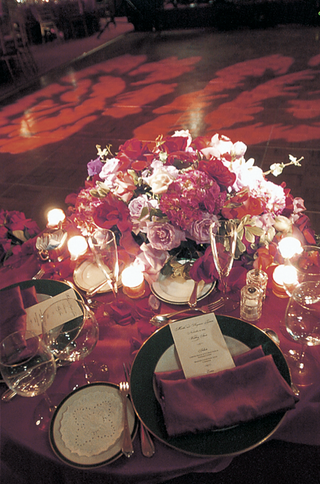 wedding-reception-table-with-red-tablecloth-and-napkins-and-bouquet-of-roses