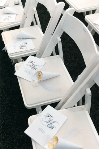 monogrammed-program-on-white-chairs