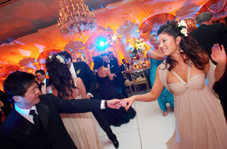 bridesmaid-dancing-on-white-dance-floor-under-chandelier