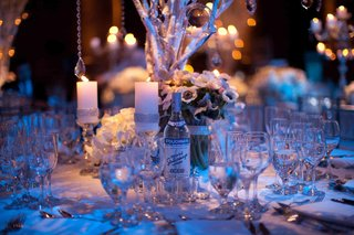 winter-wedding-centerpiece-with-blue-lighting-and-crystals