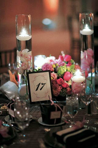 tea-lights-and-flowers-float-in-tall-glass-vases