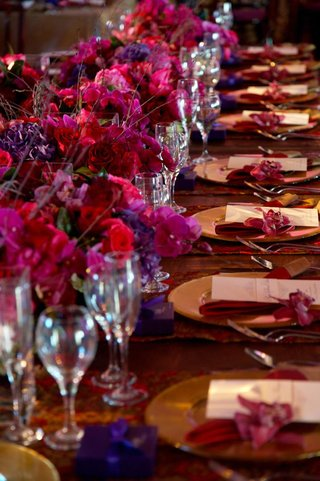 long-wedding-reception-table-with-purple-flowers