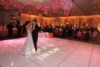 bride-in-a-vera-wang-gown-dances-with-groom-in-a-black-tuxedo