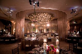 ballroom-reception-with-pale-pink-lighting-and-candles