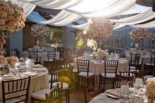 white-drapery-over-patio-wedding-reception-at-bacara-resort