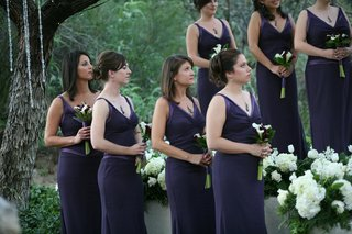 bridesmaids-in-plum-gowns-at-ceremony