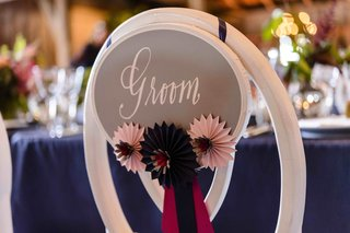 paper-origami-horse-show-ribbons-on-back-of-bride-chair