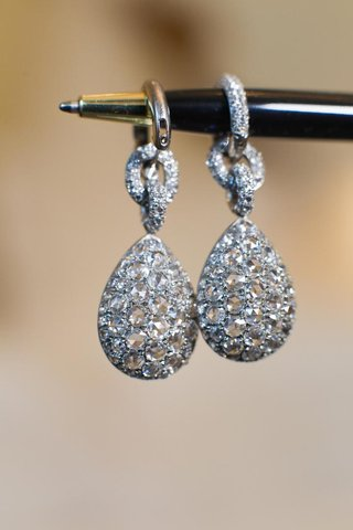 diamond-chain-link-earrings-hanging-from-ball-point-pen