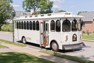 white-trolley-from-the-north-fork-trolley-co-for-a-summer-wedding-in-garden-city-ny