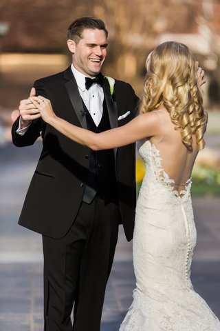 josh-and-allie-smile-at-each-other-after-their-first-look-bride-in-ines-di-santo-dress-groom-in-tux