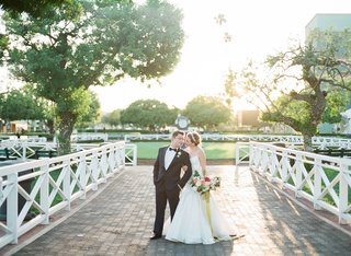 bride-in-trumpet-wedding-dress-with-groom-in-tuxedo-bow-tie-at-santa-anita-race-track-racecourse