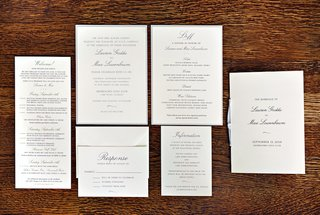 wood-background-with-white-invitation-stationery